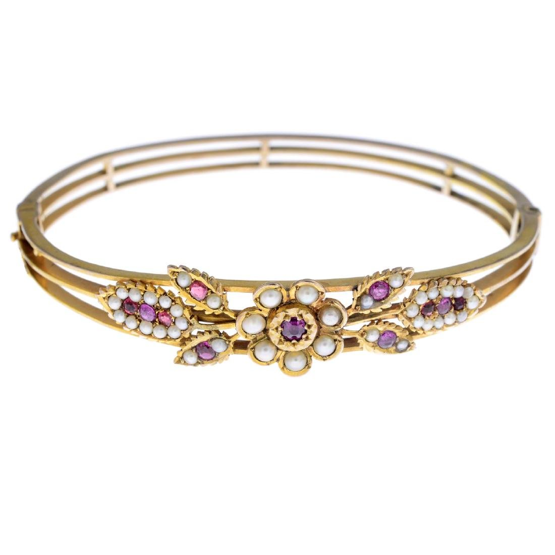 A ruby and split pearl hinged bangle. Designed as a