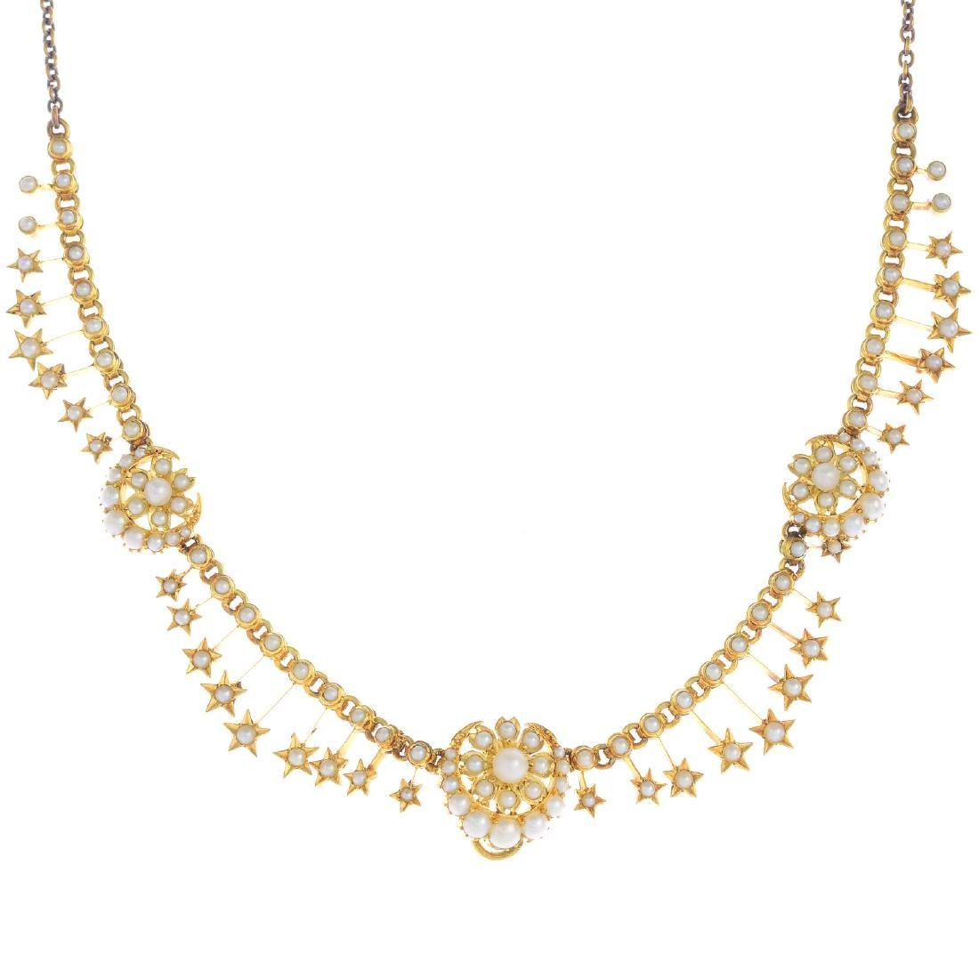 An early 20th century gold split and seed pearl