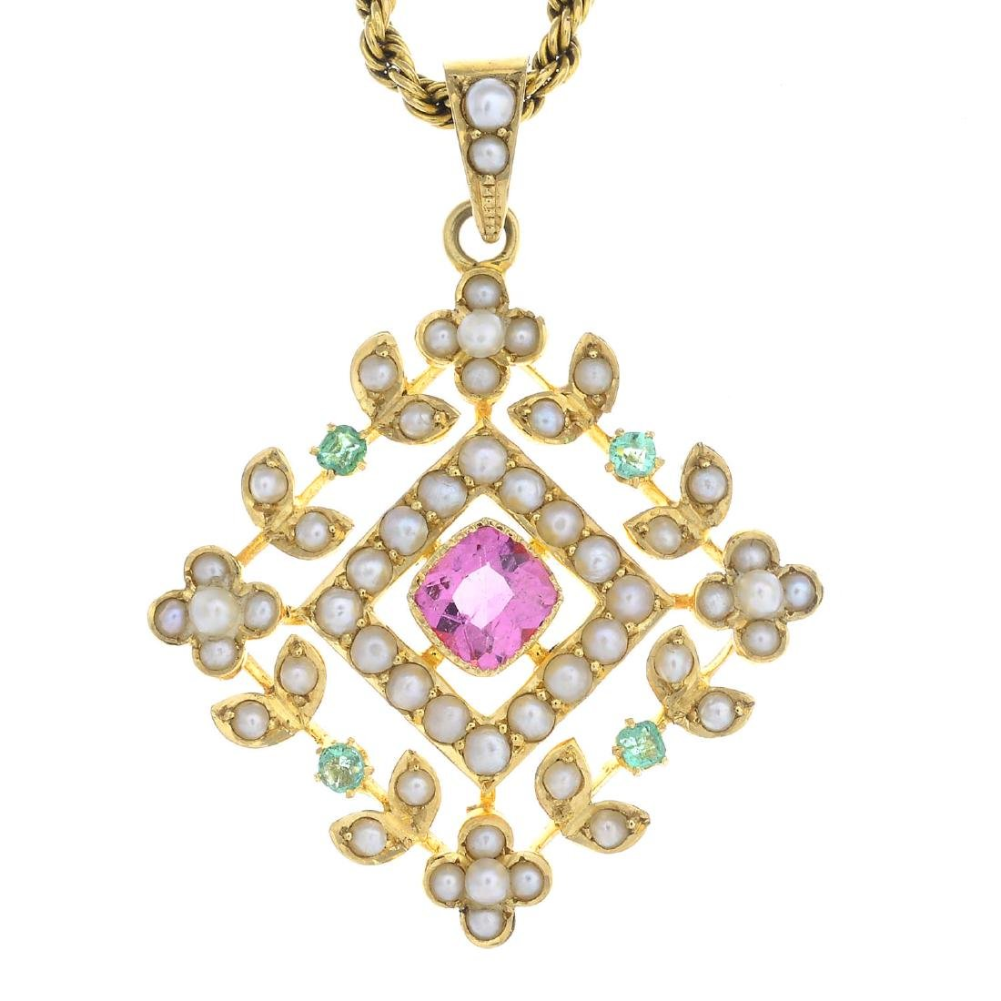 An early 20th century 15ct gold gem-set pendant. Of
