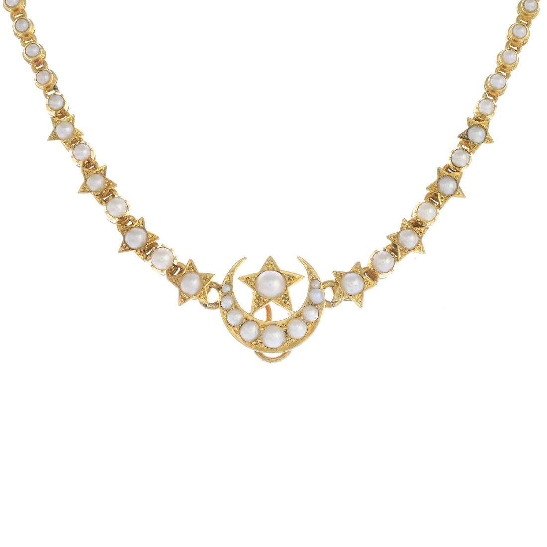 An early 20th century 18ct gold split pearl necklace.