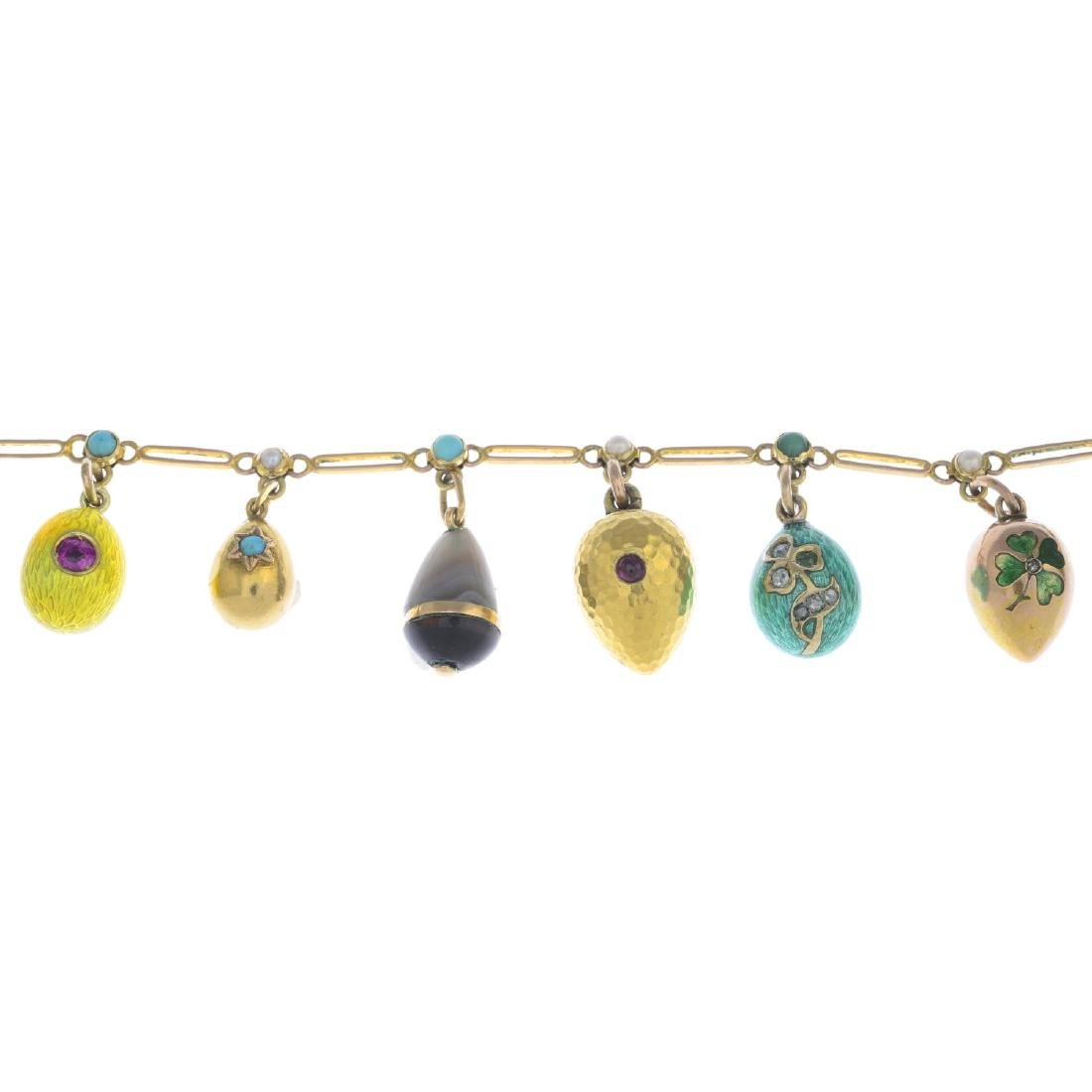 An early 20th century gold charm bracelet. The