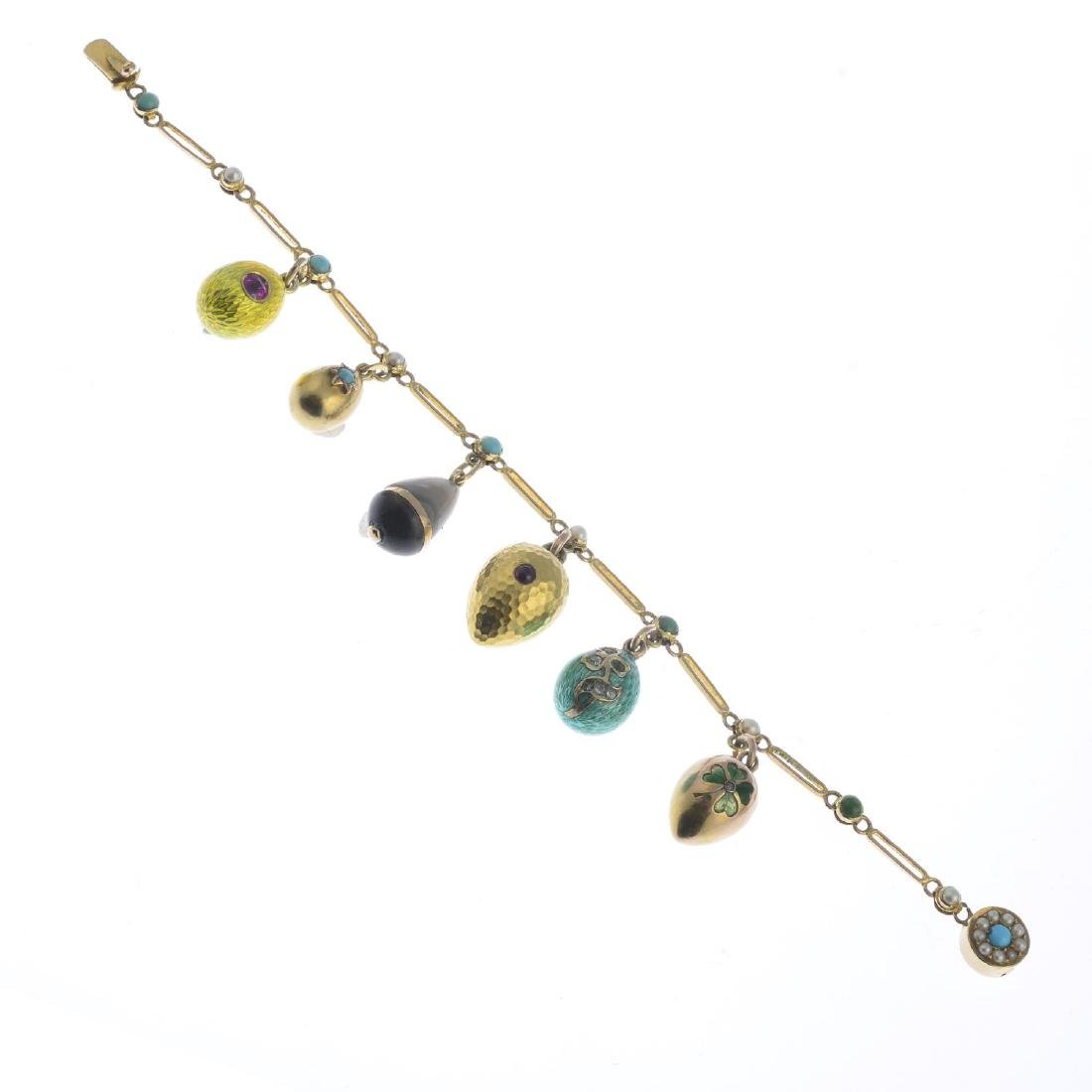An early 20th century gold charm bracelet. The - 2