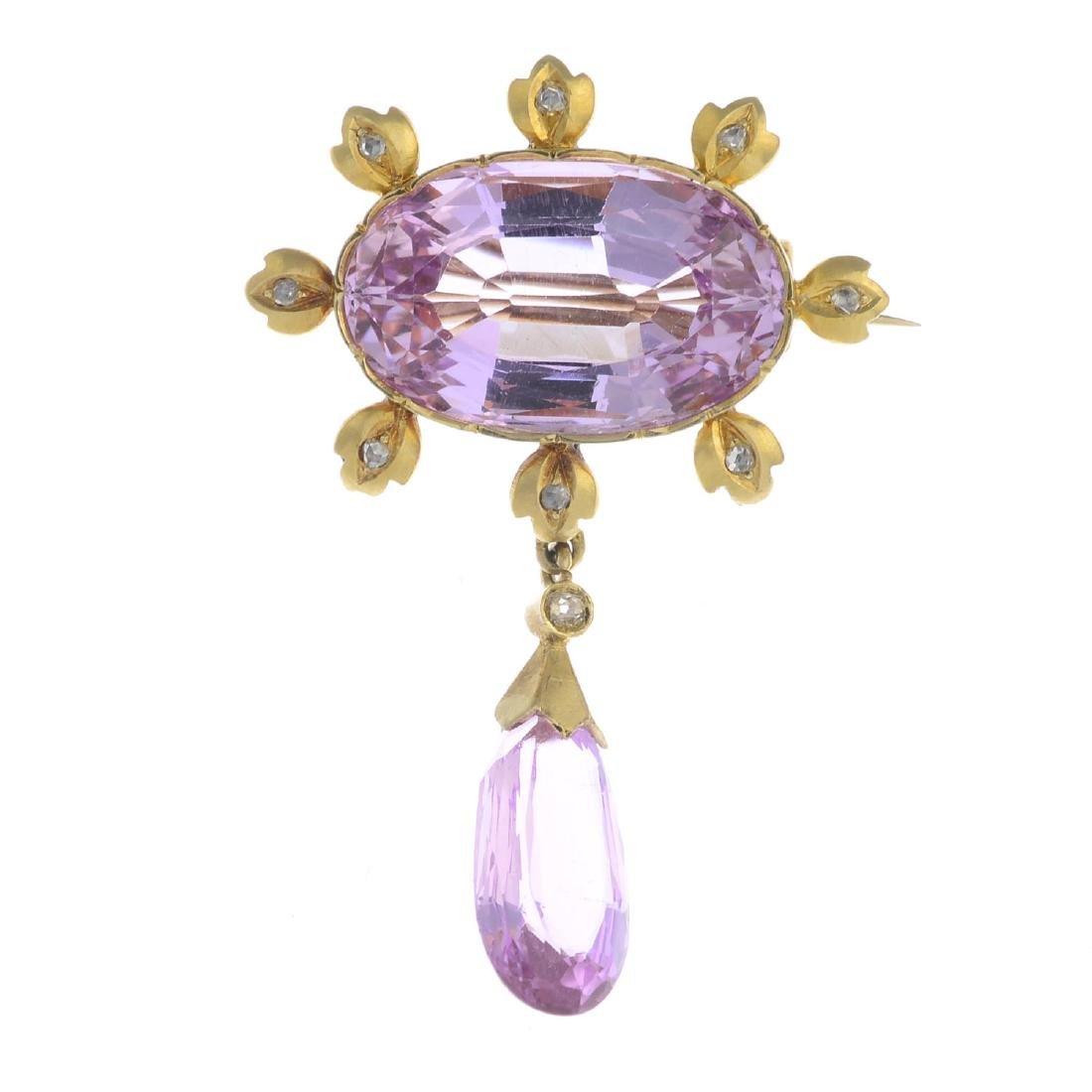 A topaz and diamond brooch. The pear-shape pink topaz