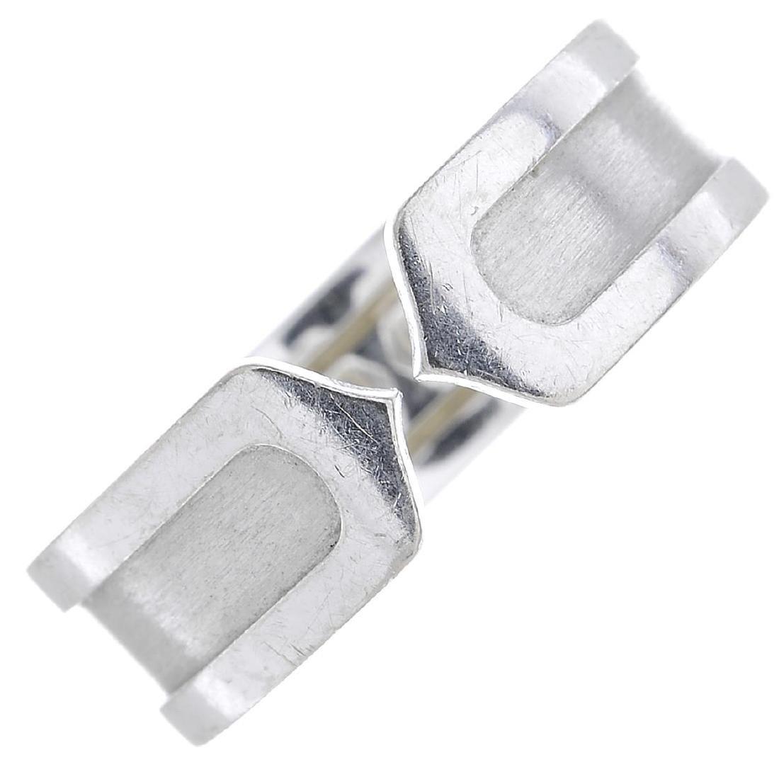 CARTIER - a 'C de Cartier' ring. Designed as an