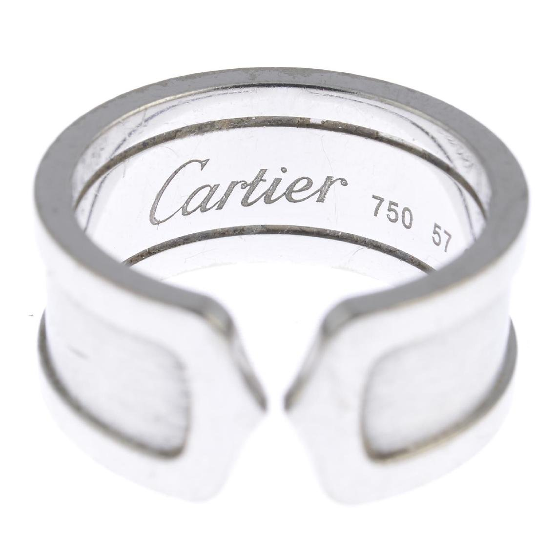 CARTIER - an 18ct gold 'C de Cartier' ring. Designed as - 2