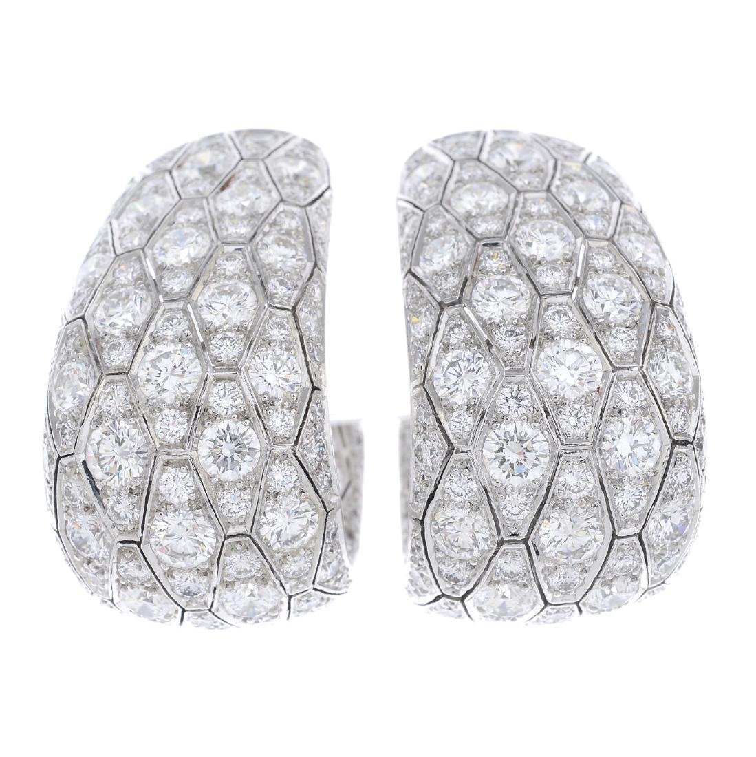 CARTIER - a pair of diamond earrings. Each designed as