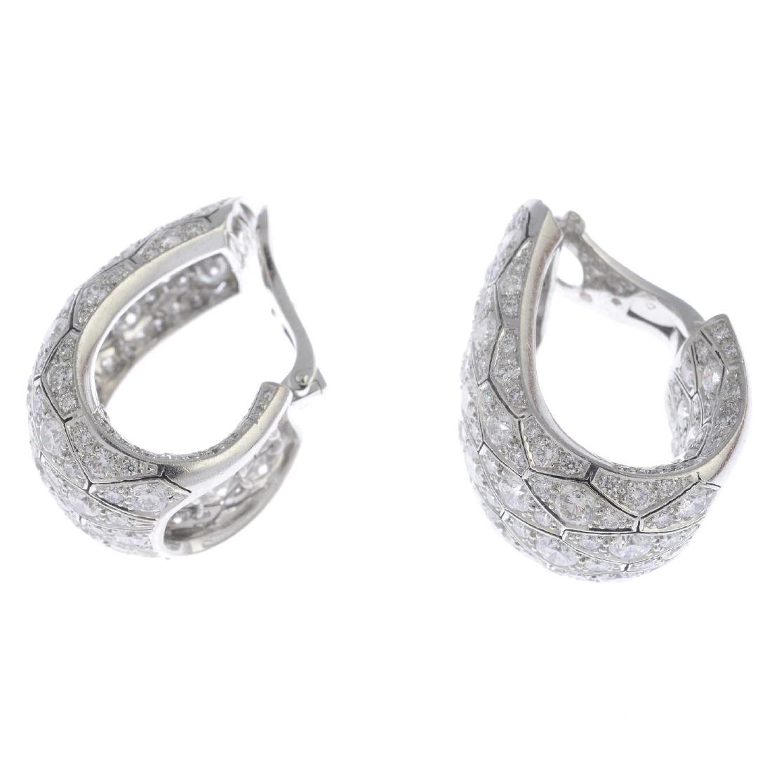 CARTIER - a pair of diamond earrings. Each designed as - 2