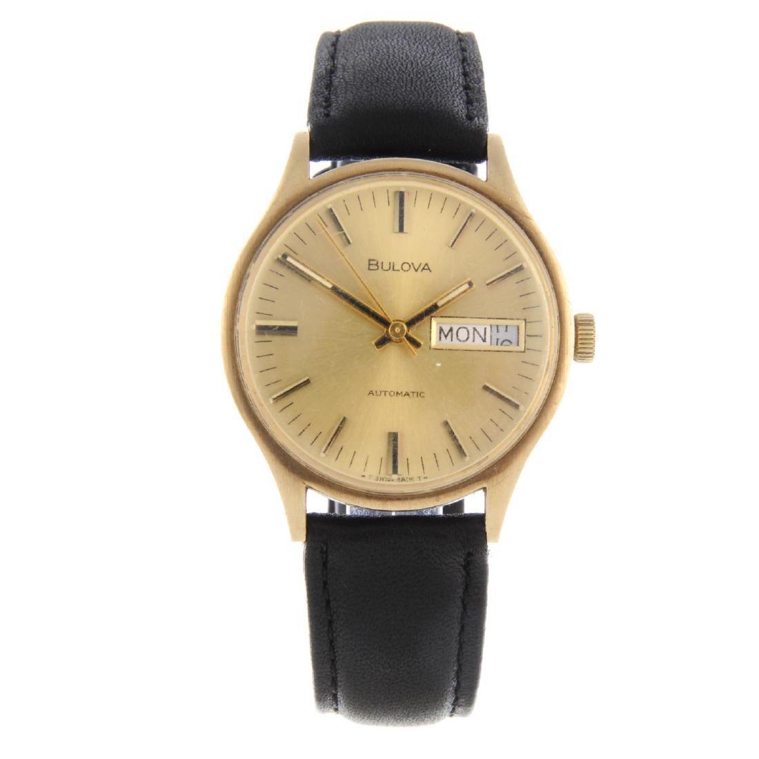 BULOVA - a gentleman's wrist watch. Yellow metal case.
