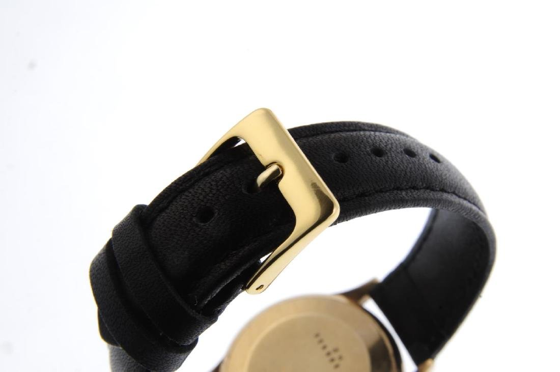 BULOVA - a gentleman's wrist watch. Yellow metal case. - 2
