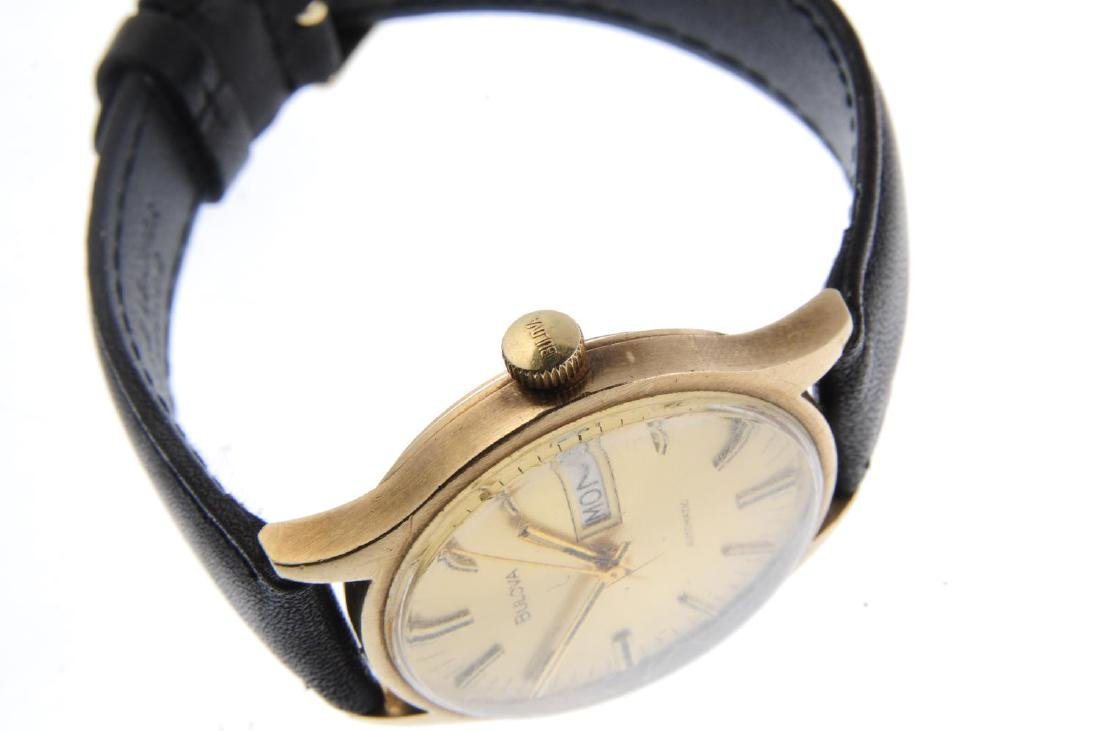 BULOVA - a gentleman's wrist watch. Yellow metal case. - 4