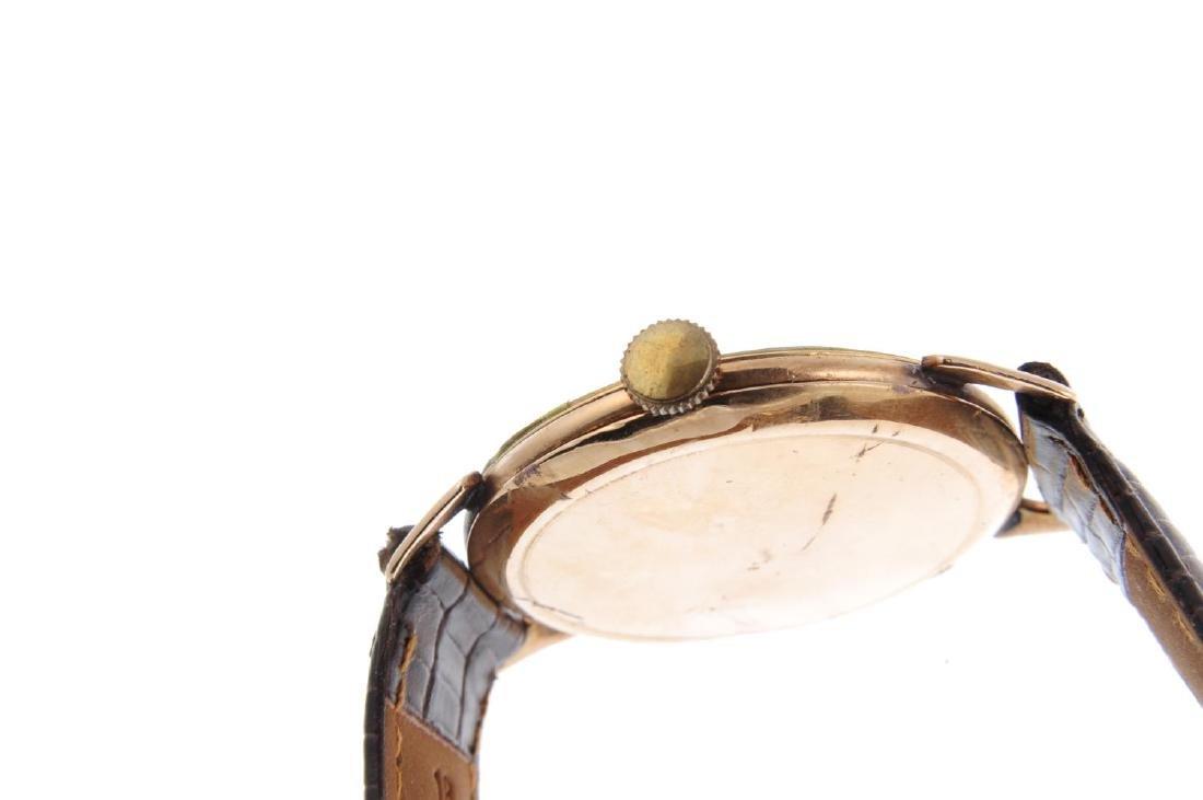 LONGINES - a gentleman's wrist watch. Yellow metal - 4