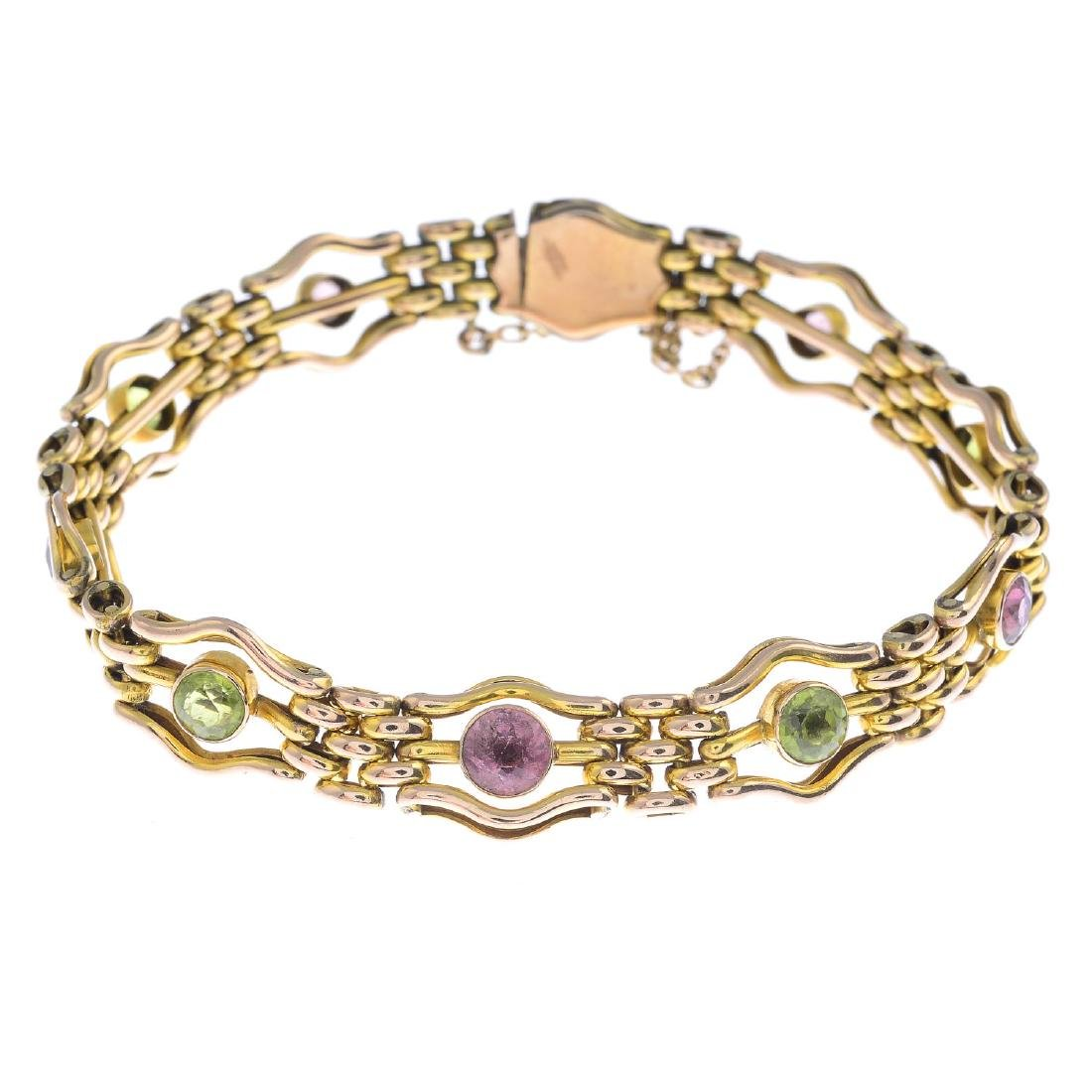 An amethyst and peridot gate bracelet. Designed as a