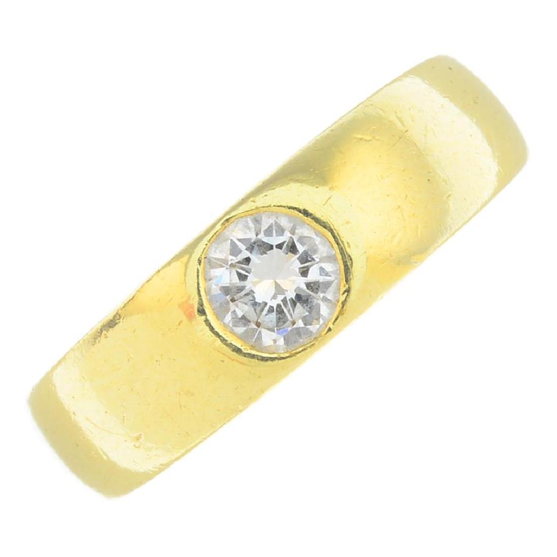 A diamond band ring. The brilliant-cut diamond, inset