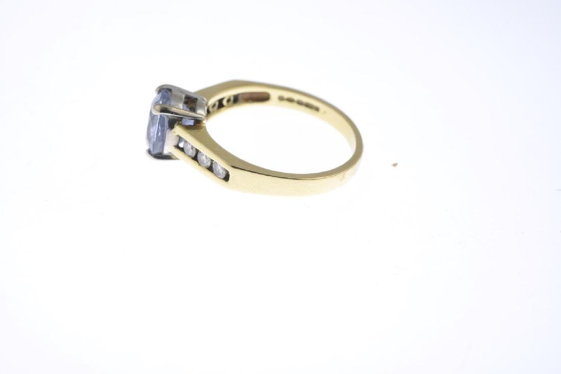 An 18ct gold sapphire and diamond dress ring. The - 2