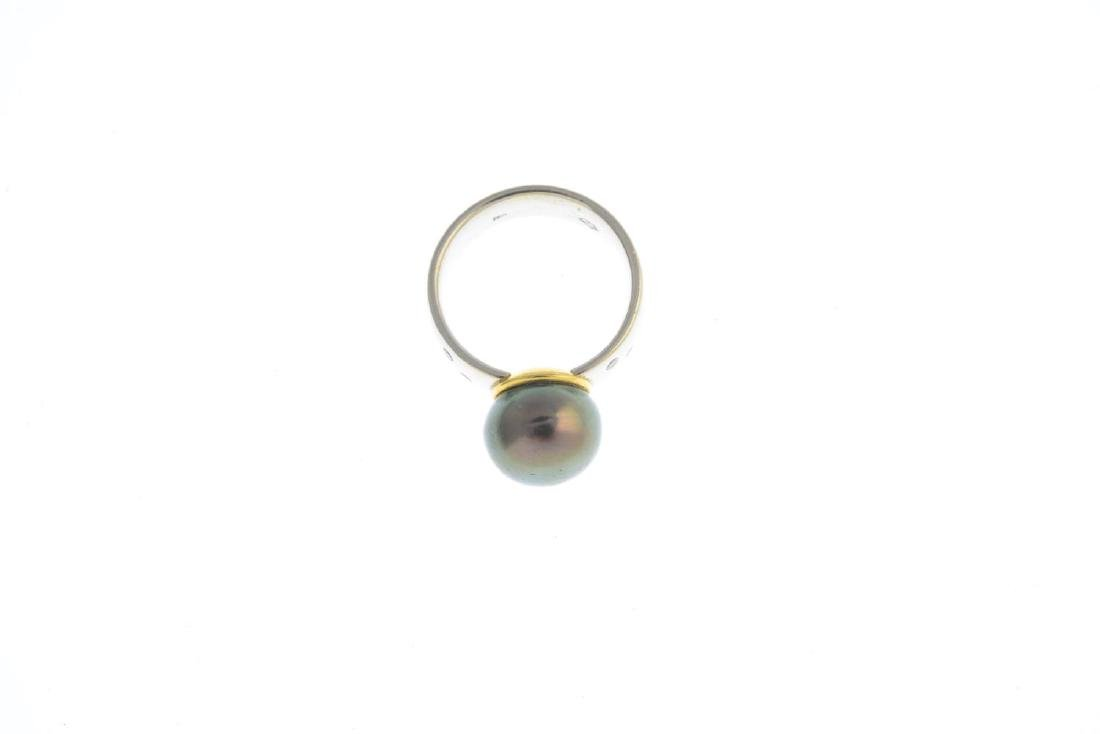 A cultured pearl and diamond dress ring. The black - 3