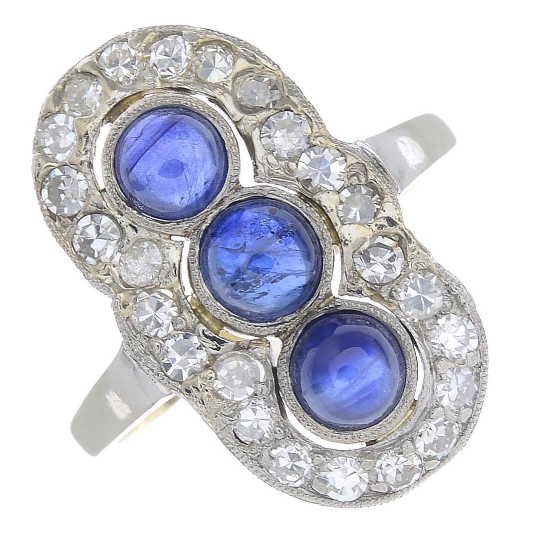 A sapphire and diamond dress ring. The circular