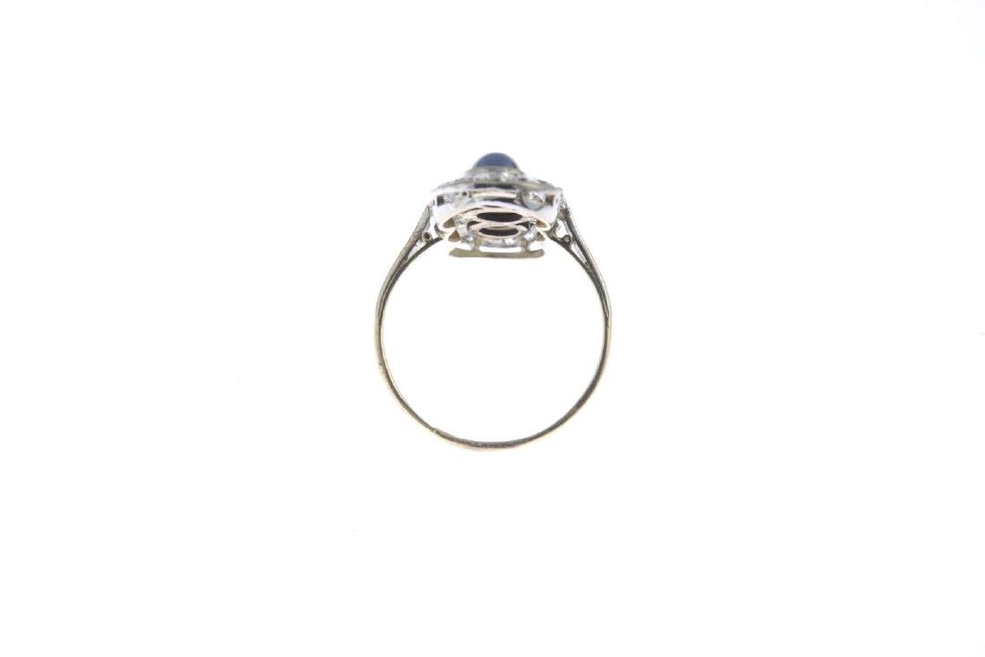 A sapphire and diamond dress ring. The circular - 3