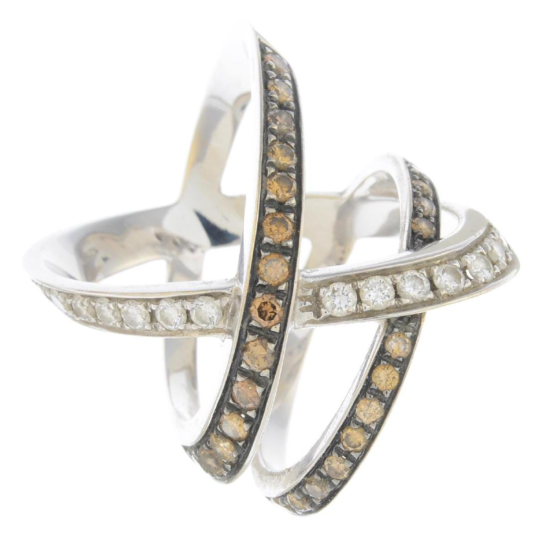 A diamond and 'brown' diamond dress ring. Of openwork