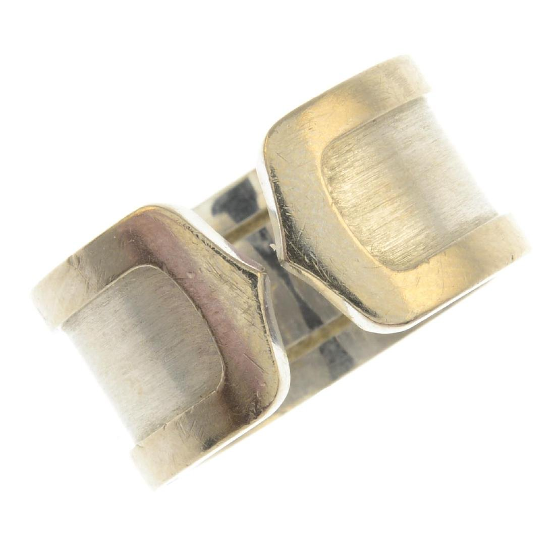 CARTIER - an 18ct gold 'C de Cartier' ring. Designed as