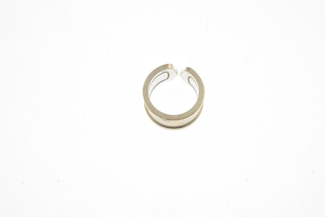 CARTIER - an 18ct gold 'C de Cartier' ring. Designed as - 2