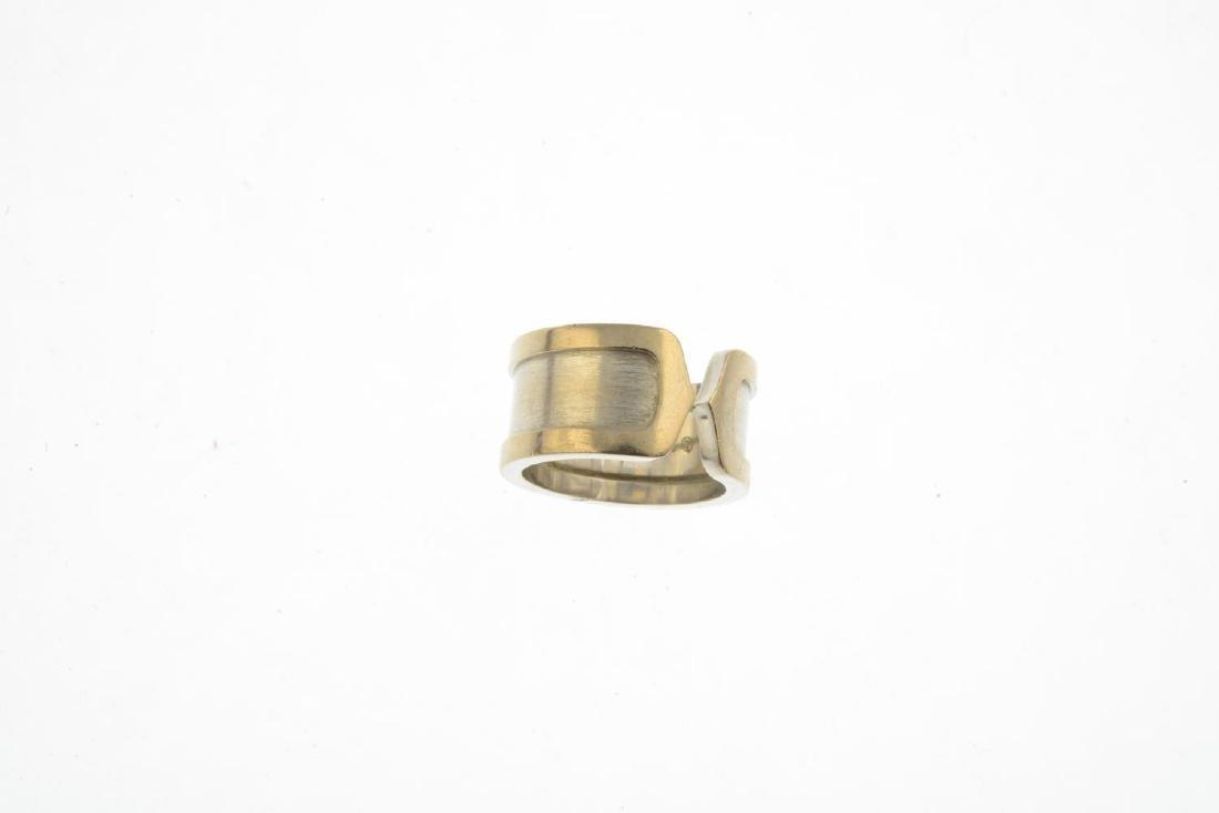 CARTIER - an 18ct gold 'C de Cartier' ring. Designed as - 3