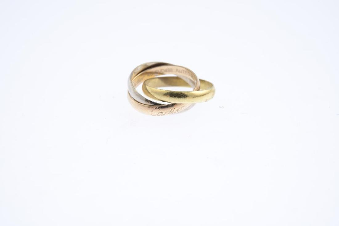 CARTIER - an 18ct gold 'Trinity' ring. Designed as - 2