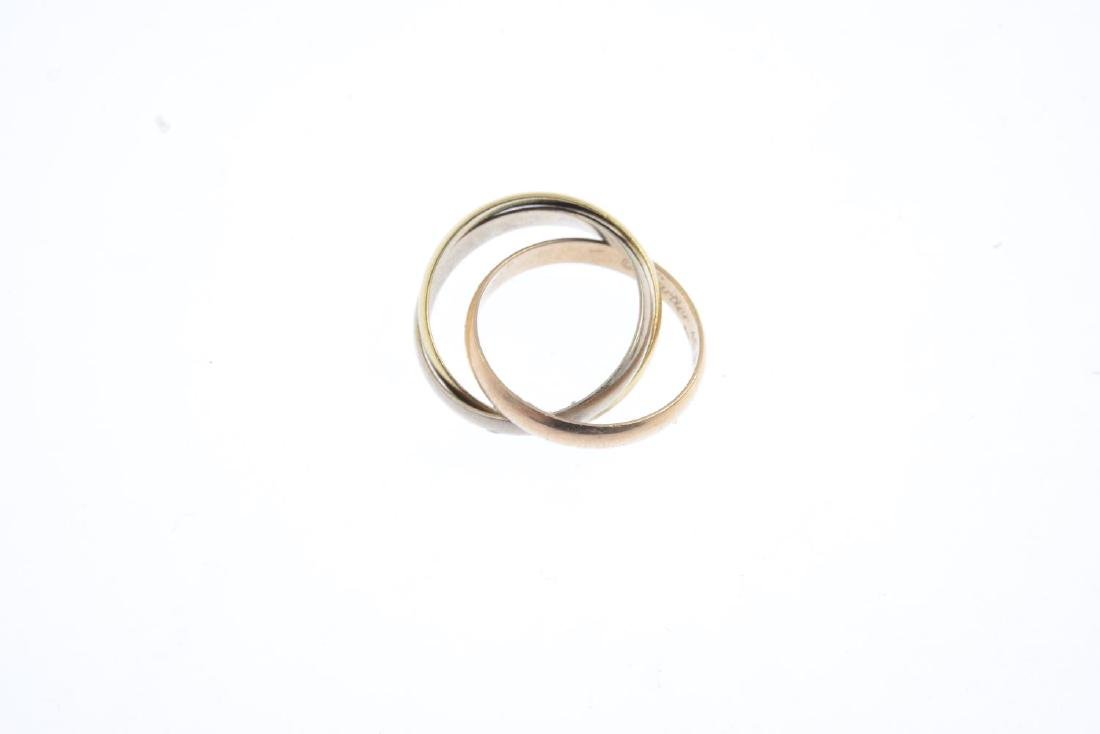CARTIER - an 18ct gold 'Trinity' ring. Designed as - 3