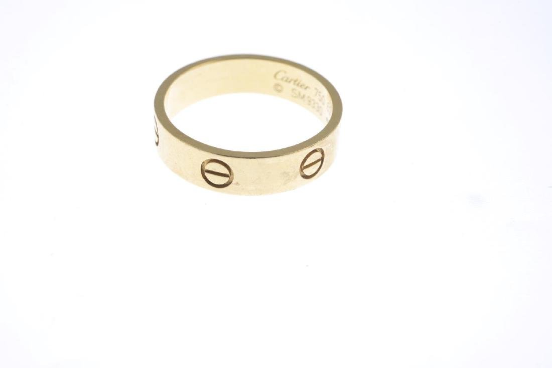 CARTIER - an 18ct gold 'Love' ring. Designed as a - 2