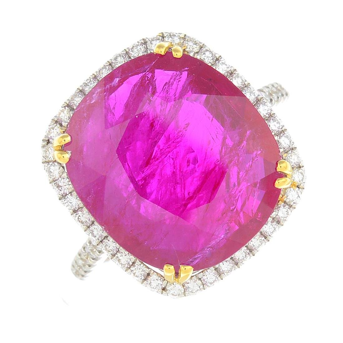 A ruby and diamond cluster ring. The cushion-shape