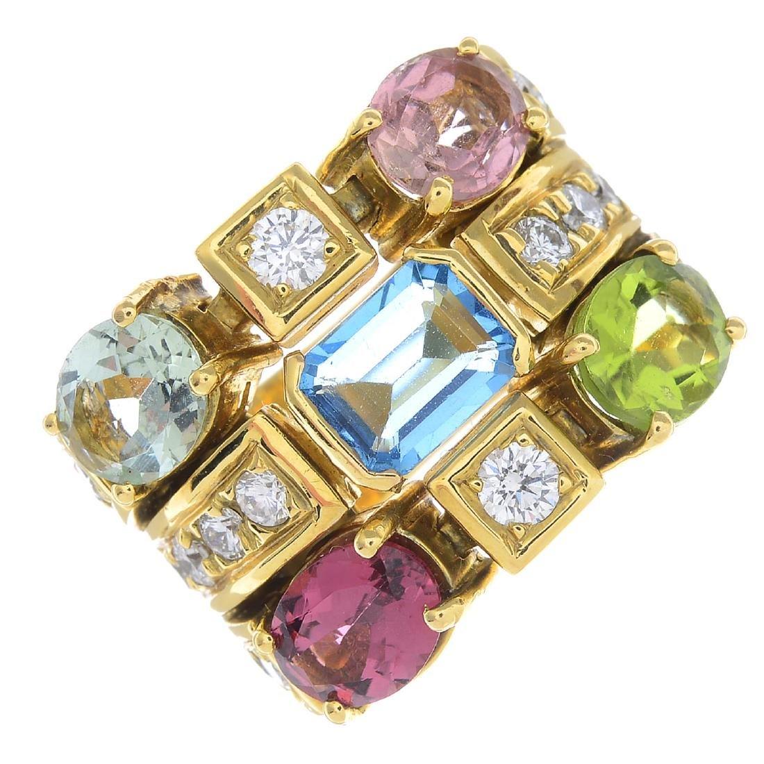 A diamond and gem-set dress ring. Designed as a