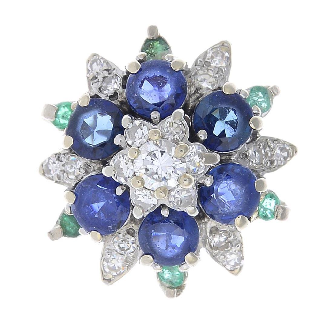 A sapphire, emerald and diamond dress ring. The