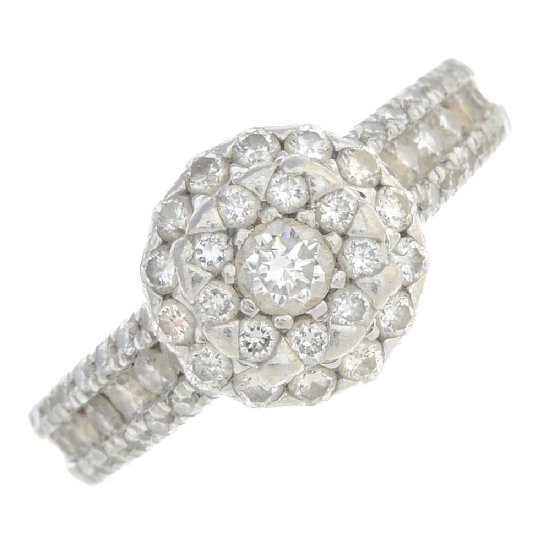 A platinum diamond dress ring. Designed as a