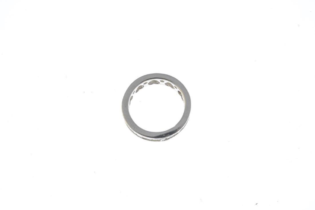 A diamond full eternity ring. The calibre-cut diamond - 2