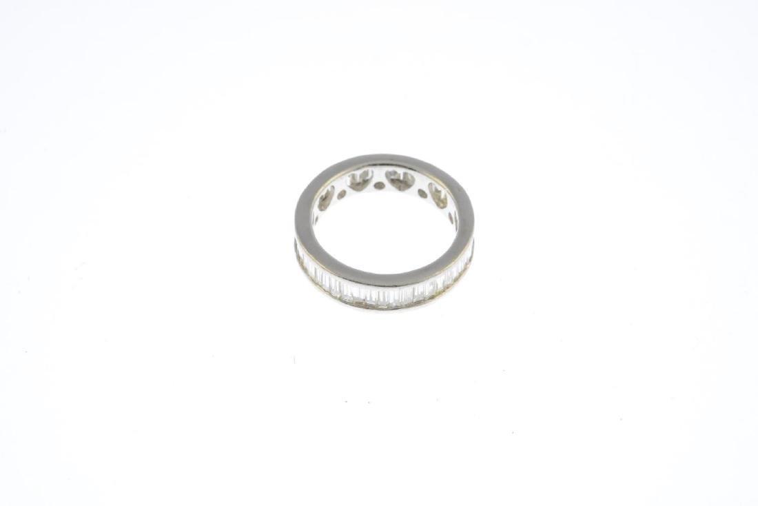 A diamond full eternity ring. The calibre-cut diamond - 3