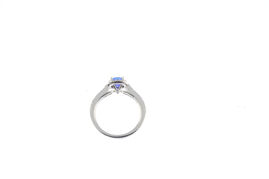 A sapphire and diamond cluster ring. The cushion-shape - 2