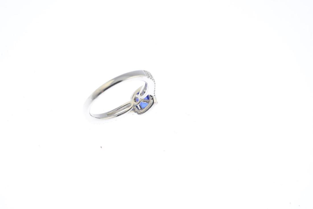 A sapphire and diamond cluster ring. The cushion-shape - 3