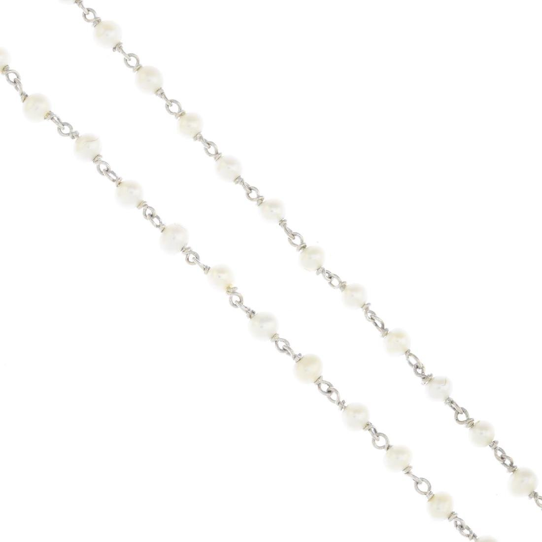 An 18ct gold seed pearl necklace. Designed as a seed