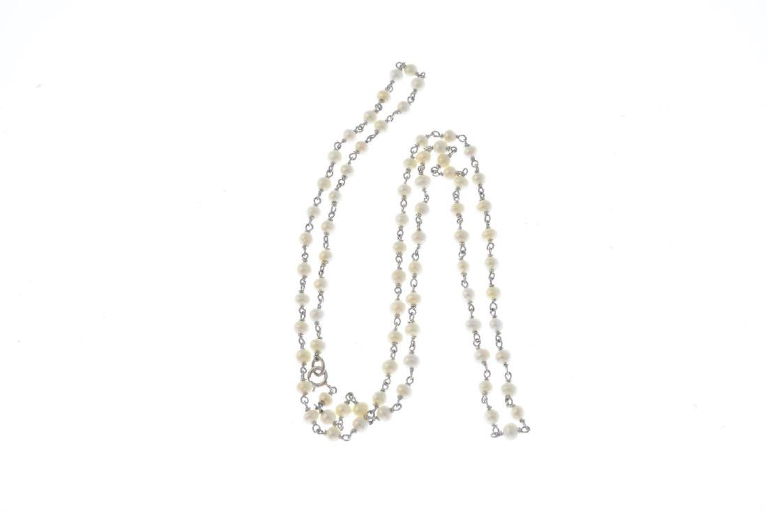 An 18ct gold seed pearl necklace. Designed as a seed - 2