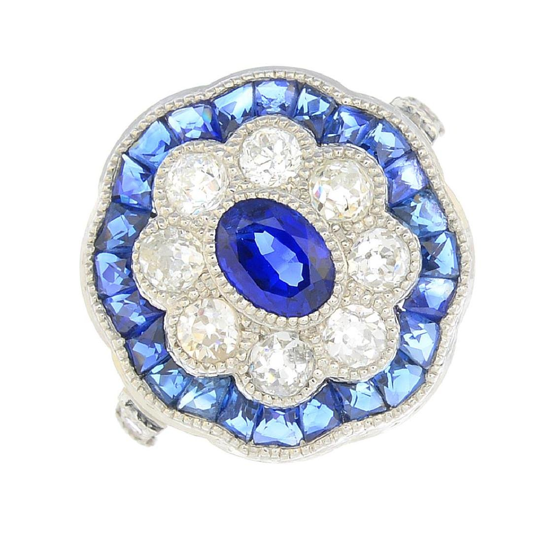 A sapphire and diamond dress ring. The oval-shape