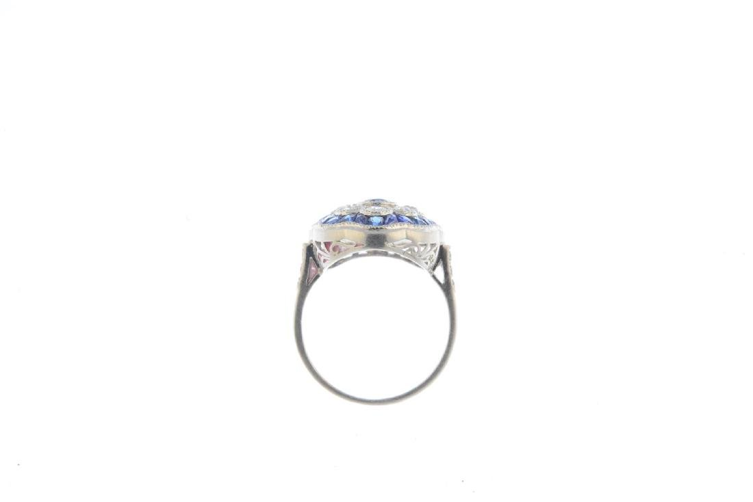 A sapphire and diamond dress ring. The oval-shape - 2