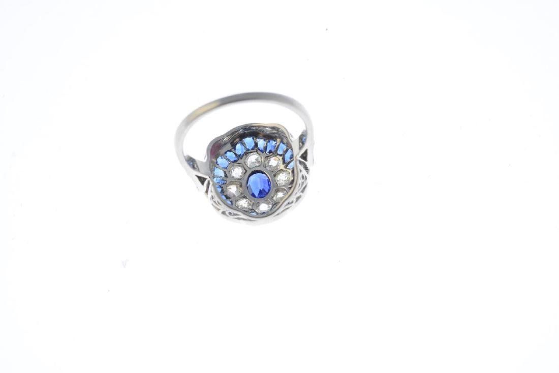 A sapphire and diamond dress ring. The oval-shape - 3