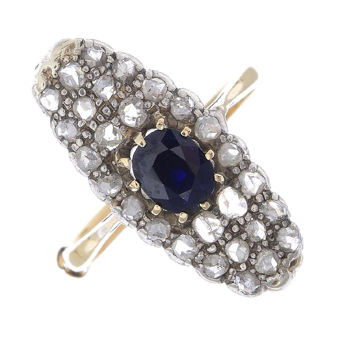 (22176) A diamond and sapphire dress ring. The