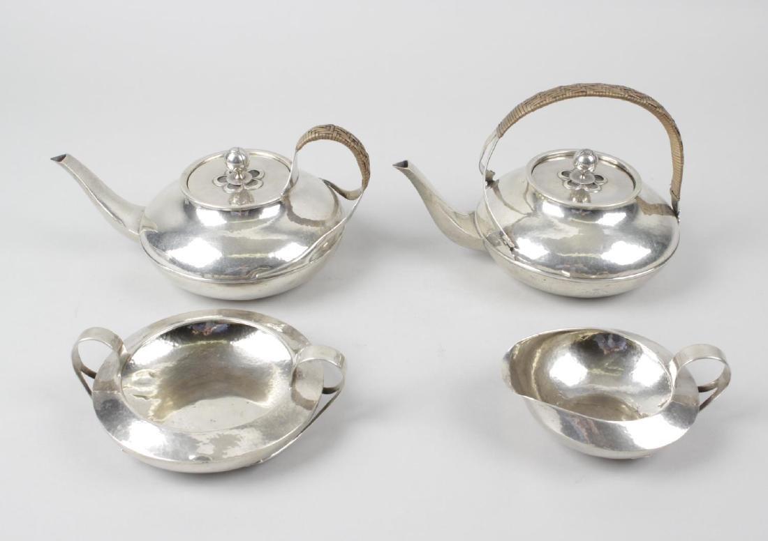 A Liberty & Co Cymric silver part tea service - 2