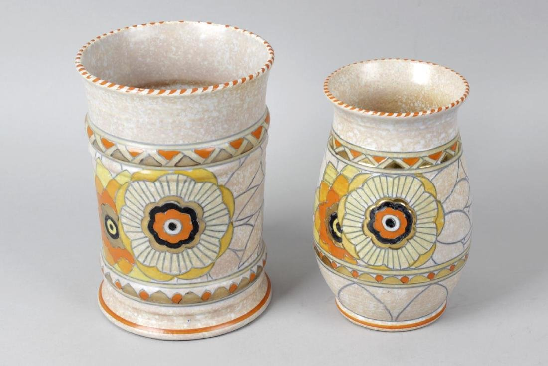 A Crown Ducal pottery charger, the grey and orange