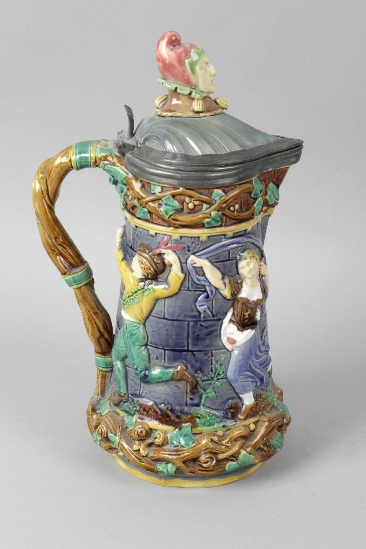 A Mintons Majolica pottery jug with pewter hinged