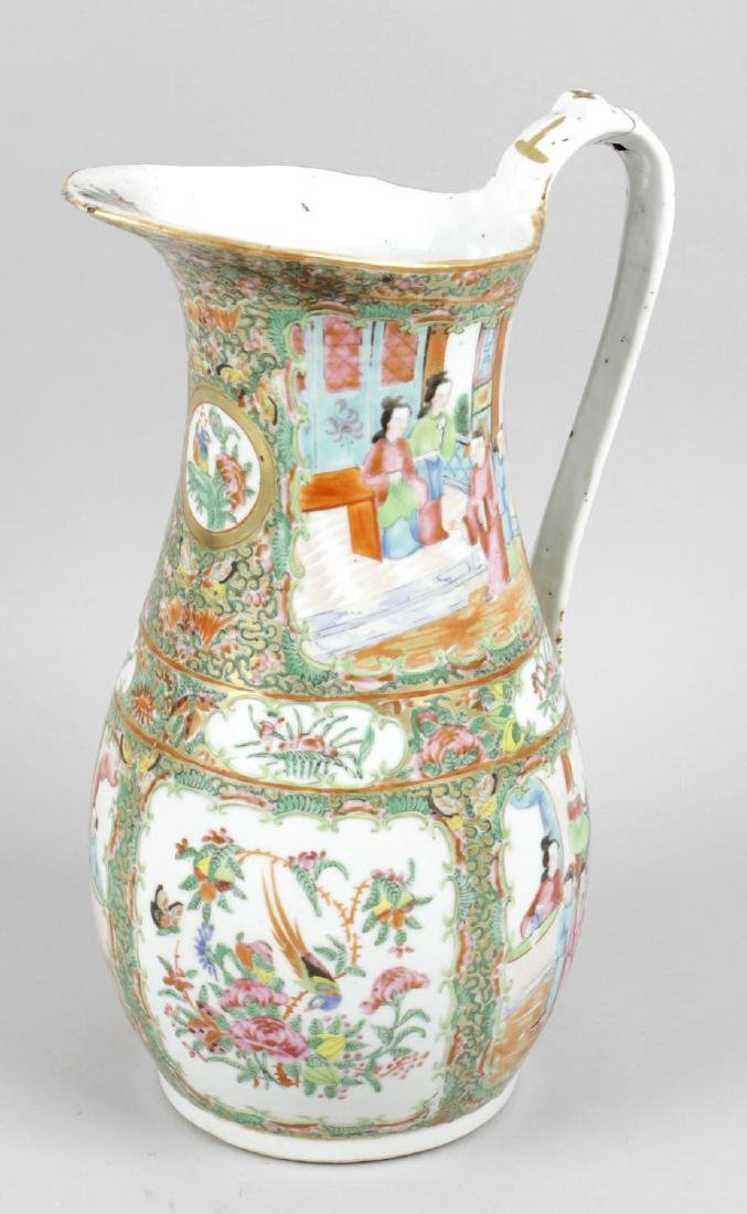 A 19th century Oriental pottery water jug, the white
