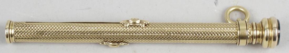 A yellow metal retractable combination fountain pen and