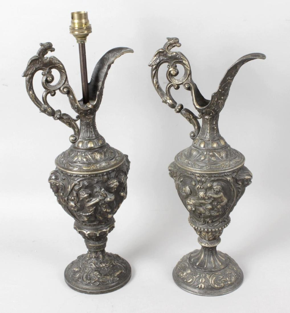 A pair of reproduction cast metal table lamps, each