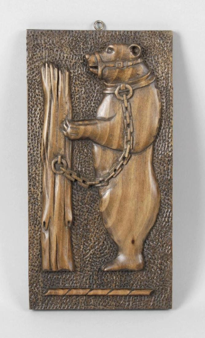 An articulated carved wall hanging dancing bear,