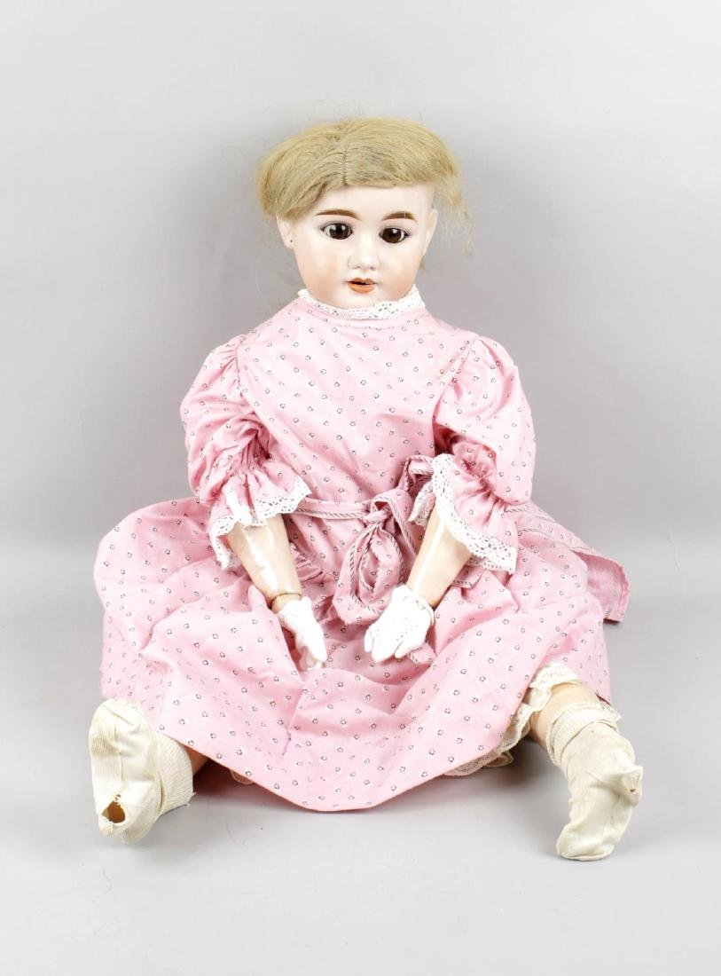 An Olympia bisque headed doll, with opening brown glass